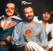 The Refugee album cover is an informal pose of the three band members.